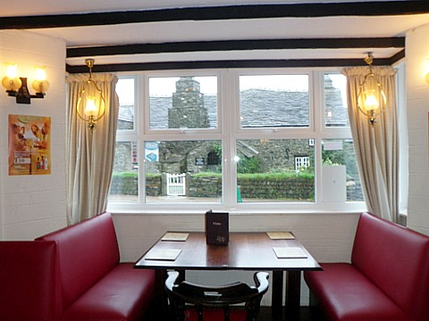 Relax over a drink, or meal and watch the world go by, your backdrop- The Tintagel Old Post Office